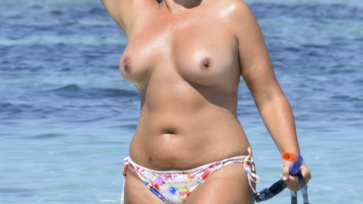 Aussie model Fiona Falkiner shows her fat tits and big belly in Ibiza