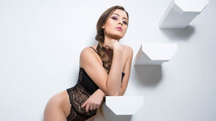 Sexy brunette Anna Zapala smokes, poses, and strips naked for you