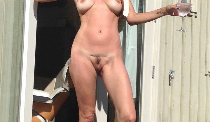 Naked MILF Catherine Bell Posing Shamelessly on the Porch