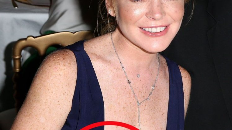 Busty Redhead Lindsay Lohan Accidentally Flashes Her Nipple
