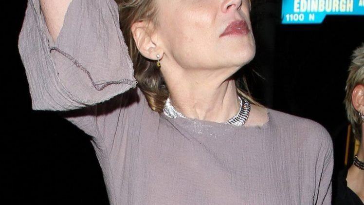 Blonde MILF Sharon Stone Showing Her Tits in a See-Through Top