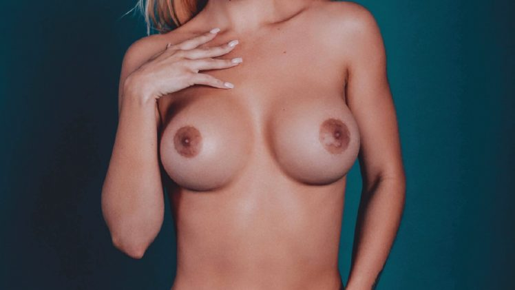 Buxom Blonde Brennah Black Shows Her Boobies on the Pages of Playboy