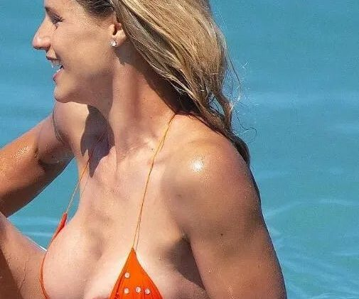 Fun-Loving Michelle Hunziker Shows Her Nipple After Accidentally Busting Out