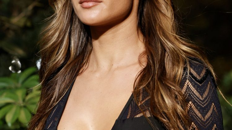 Shameless Alessandra Ambrosio Spotlights Her Cleavage While Modeling